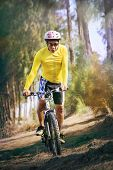Young Man Riding Mountain Bike Mtb In Jungle Track Use For Sport Healthy And Holiday Activities Life