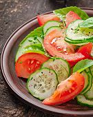 Tomato and cucumber salad with black pepper and basil
