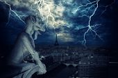 Gargoyle of Notre Dame de Paris Cathedral with lightnings , France