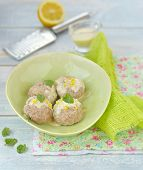stock photo of boll  - meat bolls with lemon cream sauce in to the green dish - JPG