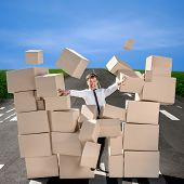 Business Man Breaking The Wall Of Carton Boxes On The Road