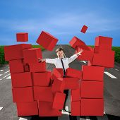 Business Man Breaking The Wall Of Carton Red Boxes On The Road