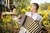 picture of accordion  - fiancee listen bridegroom play on accordion wedding humour photo - JPG