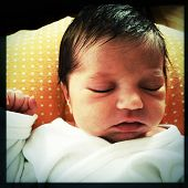 Instagram style image of a newborn infant