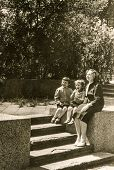 LODZ, POLAND, CIRCA 1950's: Vintage photo of mother with children in park