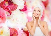 health, spa and beauty concept - beautiful woman in towel