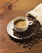 coffee cup and grains on wooden table