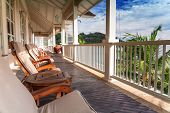 Terrace Lounge With Relaxing Armchairs And Sea View In A Luxury Resort