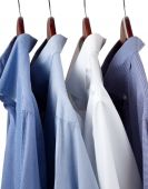 Blue Dress Shirts On Wooden Hangers