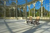 Two rocking chairs in the Crystal Palace in Madrid