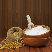 Flour In Wooden Bowl And Wheat In Burlap Bag.