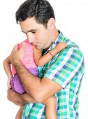 Tired and worried hispanic father carrying his small daughter isolated on white