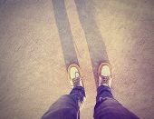 foto of flat-foot  - a shot of yellow and white boat or deck shoes done with a retro vintage instagram filter - JPG