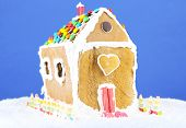 Gingerbread house on blue background