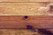 The plank, a wooden background