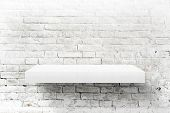 White Brick Wall And Shelf