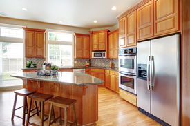pic of stool  - Kitchen room with wooden cabinets steel appliances island and stools - JPG