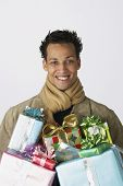 Portrait of young man with gifts