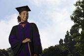 Female graduate holding document