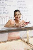 Portrait of teenage girl working in ice cream shop