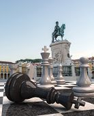 A game of chase in the middle of Commerce square in Lisbon, Portugal