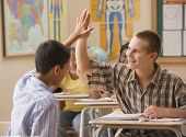 Students high fiving in class