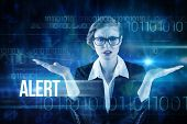 The word alert and businesswoman holding hand out in presentation against blue technology design with binary code