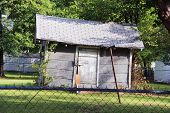 picture of neglect  - Small neglected house with a lawn - JPG
