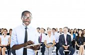 African Businessman Standing in Front of the Crowd