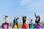 Business people infront of New York city skyline.