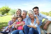 stock photo of grandparent child  - Happy 3 generation family in grandparents - JPG