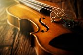 image of mozart  - violin in vintage style on wood background - JPG