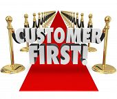Customer First words on a red carpet to illustrate importance of placing priority on client service