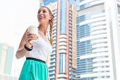 Young woman drinking coffee in metropolitan city Dubai