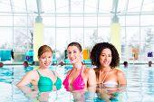 Women swimming in indoor public pool