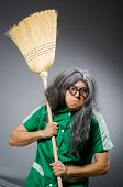 Funny man with brush and wig