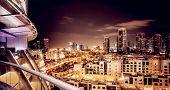 Beautiful night cityscape, Dubai, United Arab Emirates, modern futuristic buildings with many lights in dark night, luxury travel concept