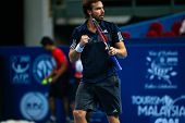 SEPTEMBER 26, 2014 - KUALA LUMPUR, MALAYSIA: Ernests Gulbis of Latvia reacts after making return shot in his match at the Malaysian Open Tennis 2014. This event is an ATP sanctioned tournament.