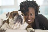 image of african animals  - Young African woman smiling with British Bulldog - JPG