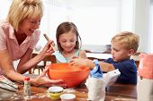 Grandmother And Grandchildren Baking Together At Home
