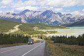 Winding Highway Next To A Mountain Lake - Alberta, Canada