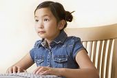 Young Asian girl using computer