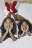 foto of pre-adolescents  - Two African American sisters on bed - JPG