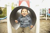Young boy in slide