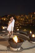 Couple hugging at resort hotel at night