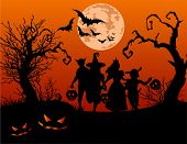 stock photo of spooky  - Halloween background with silhouettes of children trick or treating in Halloween costume - JPG