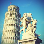The Leaning Tower of Pisa and La Fontana dei Putti Statue, Italy.  Instagram style filter