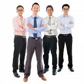 Portrait of group Southeast Asian businessmen standing isolated on white background