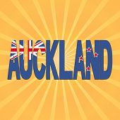 Auckland flag text with sunburst illustration