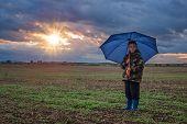 boy with umbrella before a rain